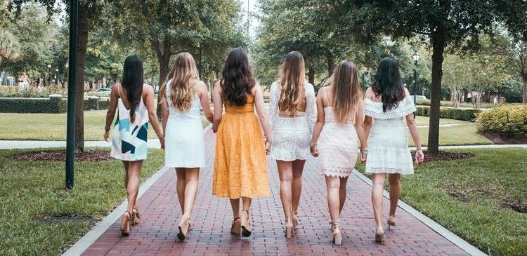 A group of women wearing light summer dresses
