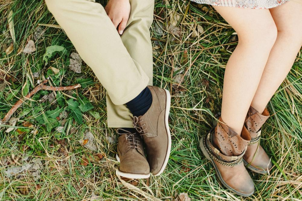 A man and woman wearing well-maintained, brown leather shoes