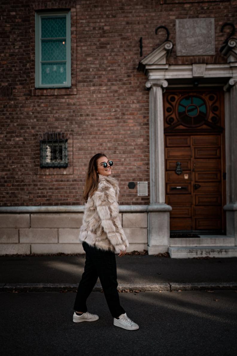 Girl wearing a faux fur coat.