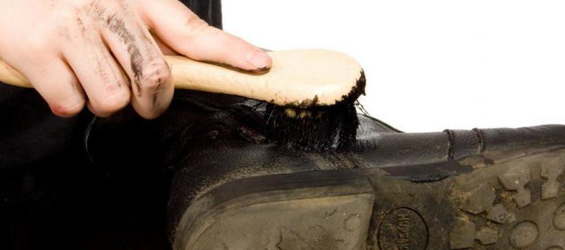A man polishing their boots