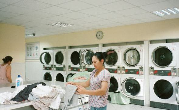 Woman standing in a Laundromat